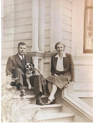 Man and a woman sitting with a bulldog-3rd generation realtor
