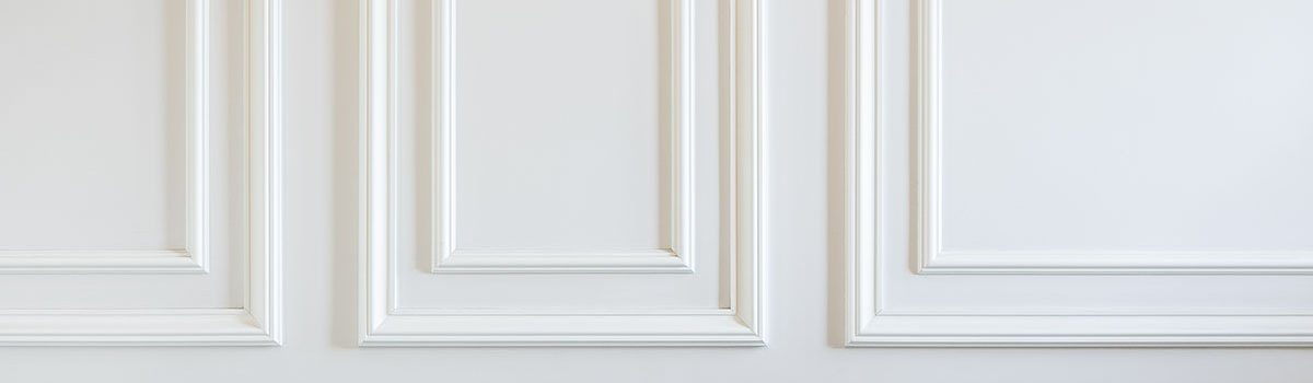 Finishing Works - Fragment Of Classic White Walls With Installed Wall Panels, Decorated With Moldings.